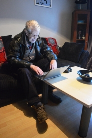 Old man working at laptop