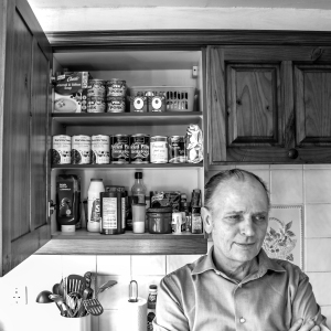 Man with open cupboard