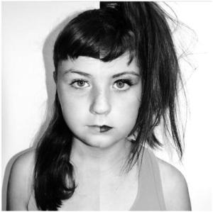 Girl with face half 'made-up'