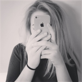 Girl with smartphone in front of face