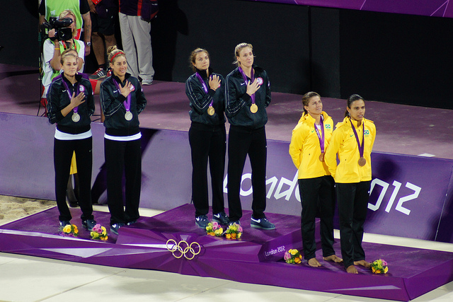 The London 2012 Beach Volleyball medallists during the US National Anthem. Photo by Daniel Coomber.